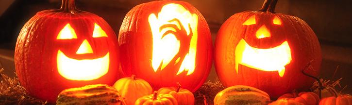 Drie halloween pompoenen